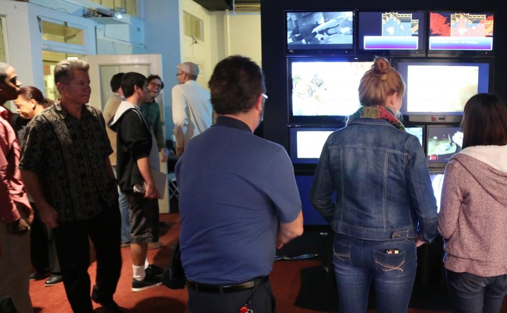 People Watching Vieo Wall